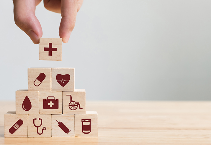 Cubes with health icons stacked in a pyramid