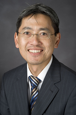 Headshot of PCH Executive Director Dr Victor Cheng in suit and tie